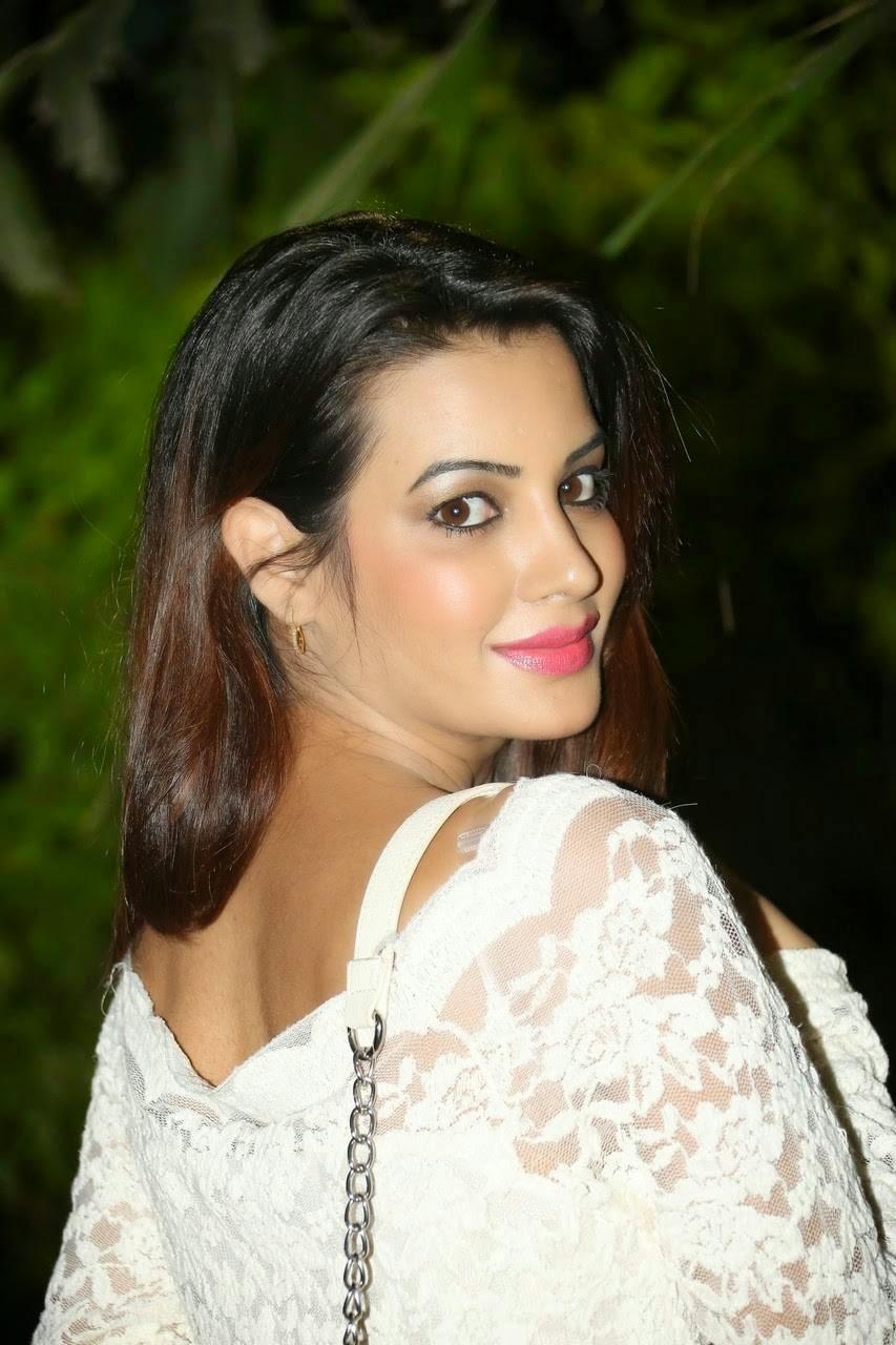 Actress Diksha Panth Photos, Actress Diksha Panth Crossleg Sitting Pics in White Dress from Event