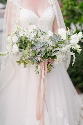 bride with pink flowers and cathedral style veil