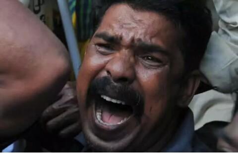 Crying Afghan man