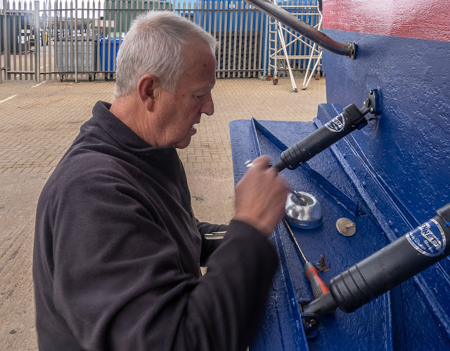 Photo of Phil fitting a new anode on one of Ravensdale's trim tabs