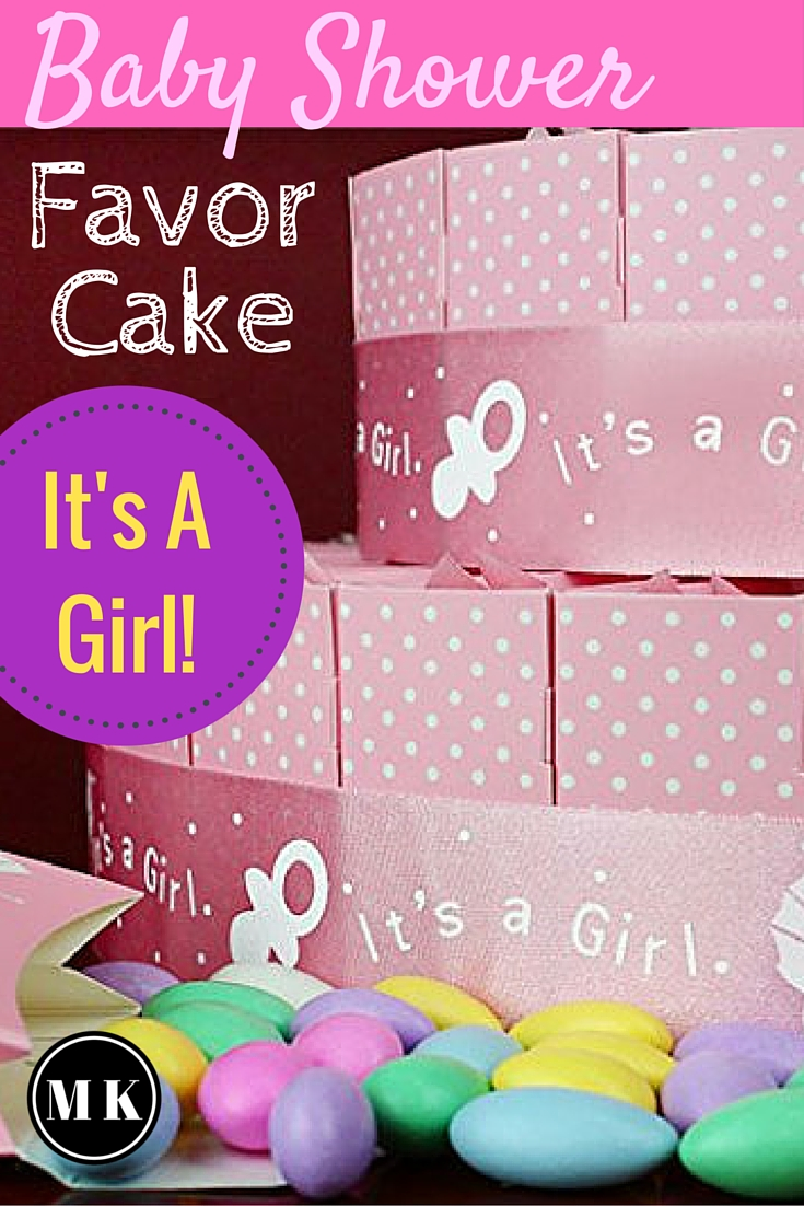 "Baby Shower Favor Cake Kit For Girls – These pink thank you gifts for your guests are surprisingly inexpensive and don't take long to assemble. All you will need to complete the display is some candy to put inside the favor boxes. The ""cake"" looks impressive with very little effort, and if you're ready for some DIY, I have a few ideas on how to personalize them for your party too!"