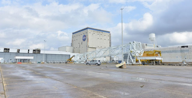 Machinery is seen damaged in a parking lot at Michoud. Photo Credit: Steven Seipel / MAF / NASA