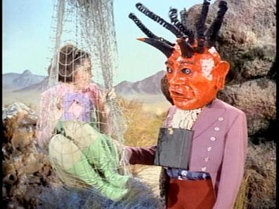 A corny villain menaces Penny in Lost In Space 1965 movieloversreviews.blogspot.com
