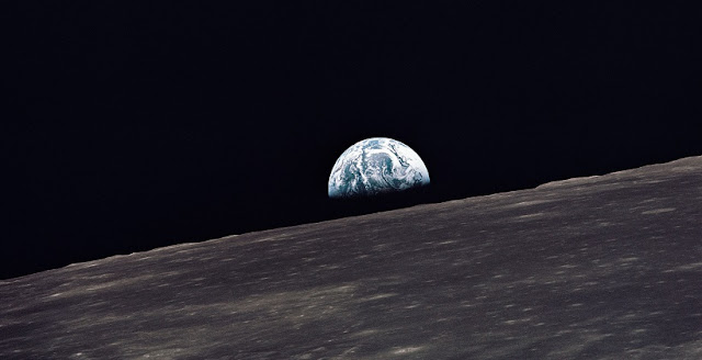 A view of Earth rising above the lunar horizon photographed from the Apollo 10 Lunar Module, looking west in the direction of travel. The Lunar Module at the time the picture was taken was located above the lunar farside highlands at approximately 105 degrees east longitude. Credit: NASA