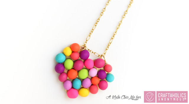 http://www.craftaholicsanonymous.net/diy-mini-pompom-heart-necklace