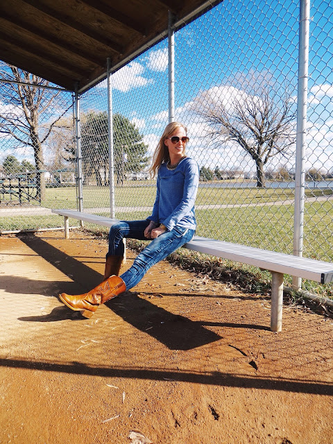SammyDress long sleeved blue tee, Emblem Eyewear brown and gold aviator sunglasses, Happiness Boutique tribal necklace, Deb skinny jeans, cowboy boots, casual outfit