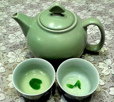 Pot of Tea with Two Cups Partially Drunk-up
