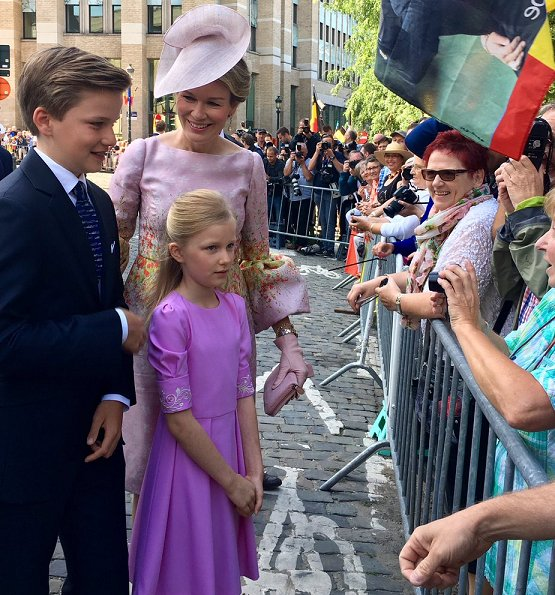 King Philippe, Queen Mathilde, Crown Princess Elisabeth,  Princess Eleonore, Prince Gabriel and Prince Emmanuel at Belgian National Day. Natan Dress, Valentino