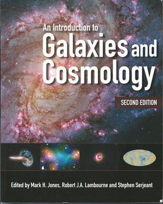 "Resident Astronomer at the AAS 231 picks up copy of great book, ""An Introduction to Galaxies and Cosmology"""