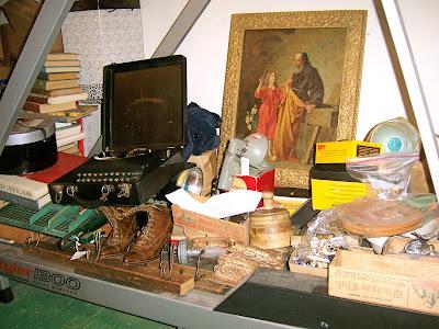 Antique boots, typewriter, paper cutter, butter mold, framed lithograph art