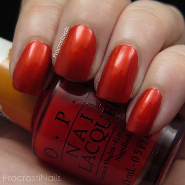 Swatch of OPI Chromatic Orange which is a bright orange jelly polish
