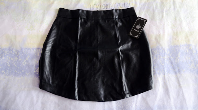 Details on the curved faux leather black bodycon skirt from Dresslink.