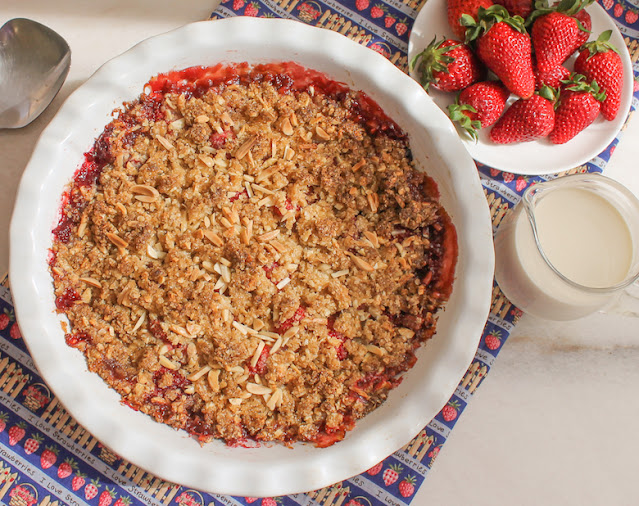 Food Lust People Love: Strawberry almond crumble pairs our favorite sweet red berries with a buttery almond oatmeal topping that also happens to be gluten-free. And since it's so quick and easy, this is the perfect dessert to make for your sweeties today for Valentine's Day.