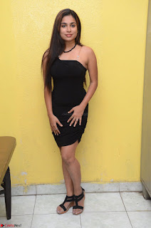 Vrushali Gosavi in strapless Short Black Dress At Follow Follow U Audio Launch 086.JPG