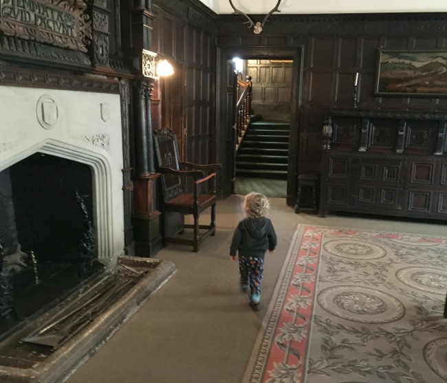 toddler-walking-past-grand-fireplace-St-Fagans-Castle