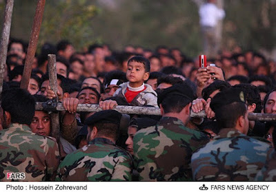 Watching a public execution in Iran.