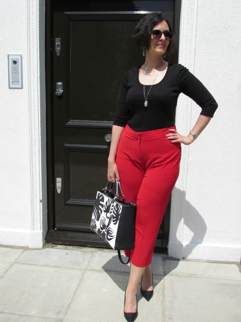 Red culottes, black top and black heels