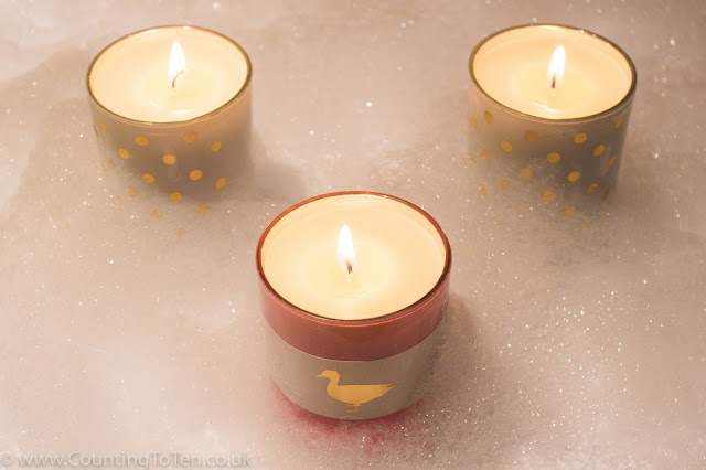 3 candles surrounded in bubbles