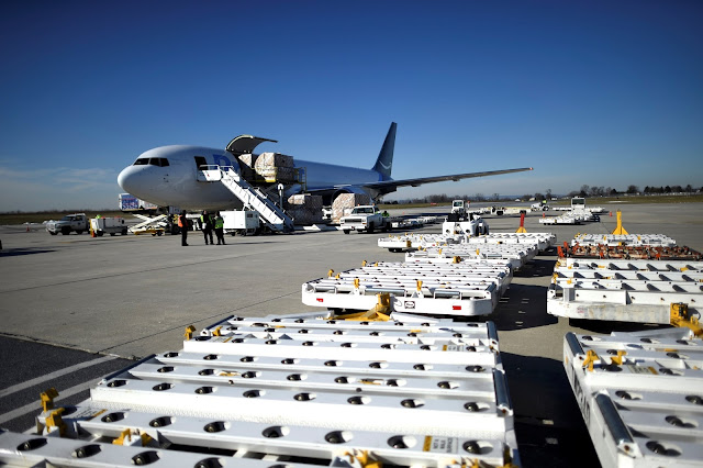 Image Attribute: A wide body aircraft emblazoned with Amazon's Prime logo is unloaded at Lehigh Valley International Airport in Allentown, Pennsylvania, U.S. December 20, 2016.    REUTERS/Mark Makela
