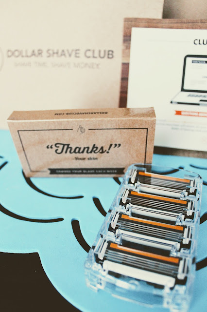 """Dollar Shave Club Canada- The 4X """"The Lover's Blade"""" shipping package, four cartridge blades, paper case and card stock flyer."""