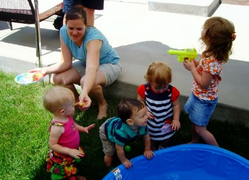 Kiddie pool with toys as a toddler birthday party game