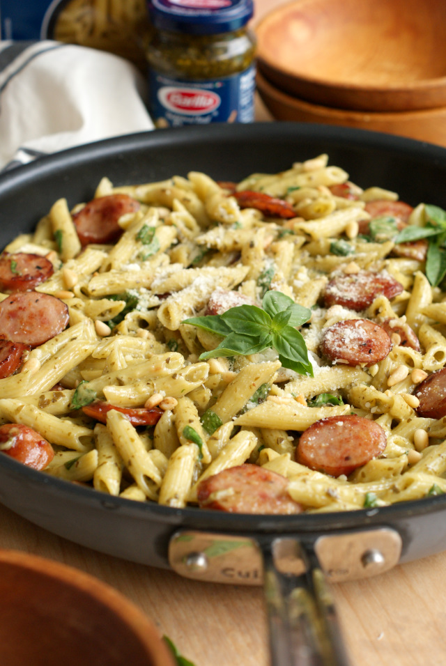 One Pan Sausage and Creamy Pesto Pasta from The Two Bite Club is a cheesy, hearty, family-friendly dinner that is on the table in just 20 minutes and cooks in just one pan! #OnePanPronto @walmart #ad