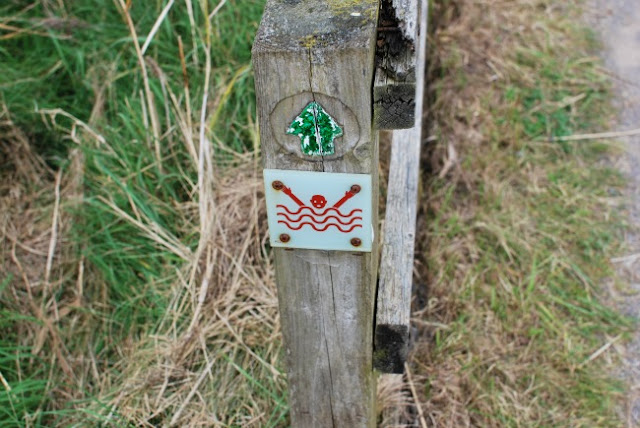A-Day-Out-at-RSPB-Newport-Wetlands-warning-sign-of-stickman-drowning