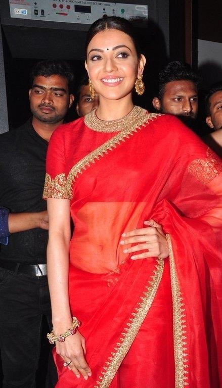 Kajal Aggarwal Navel Show Photos In Transparent Red Saree