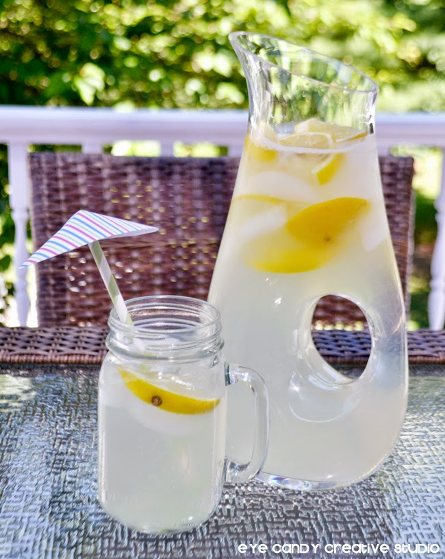 drink umbrellas, pitcher of lemonade, cut lemons, lemon juice, ice