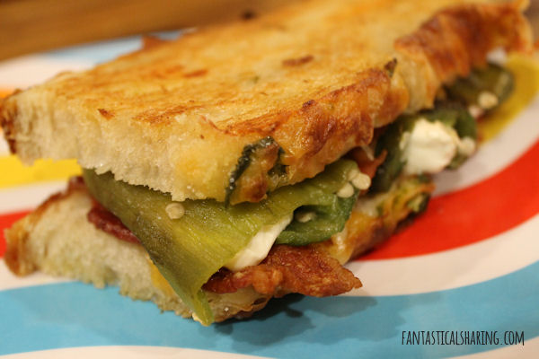 Outrageous Jalapeno Popper Grilled Cheese // This grilled cheese is outrageously good with its cream cheese stuffed jalapenos, bacon, and cheese on jalapeno cheese bread #recipe #jalapeno #grilledcheese