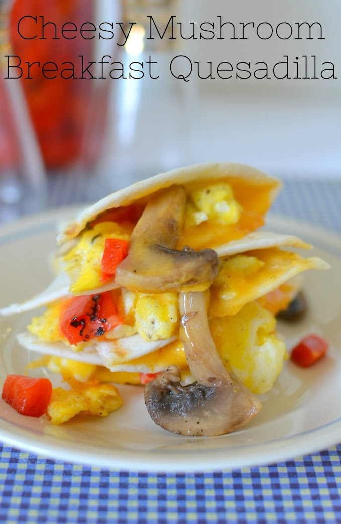 Cheesy Mushroom Breakfast Quesadilla Recipe from Hot Eats and Cool Reads! These delicious mushroom quesadillas are packed with scrambled eggs, roasted red peppers and shredded cheddar cheese! Such a great way to start the day!