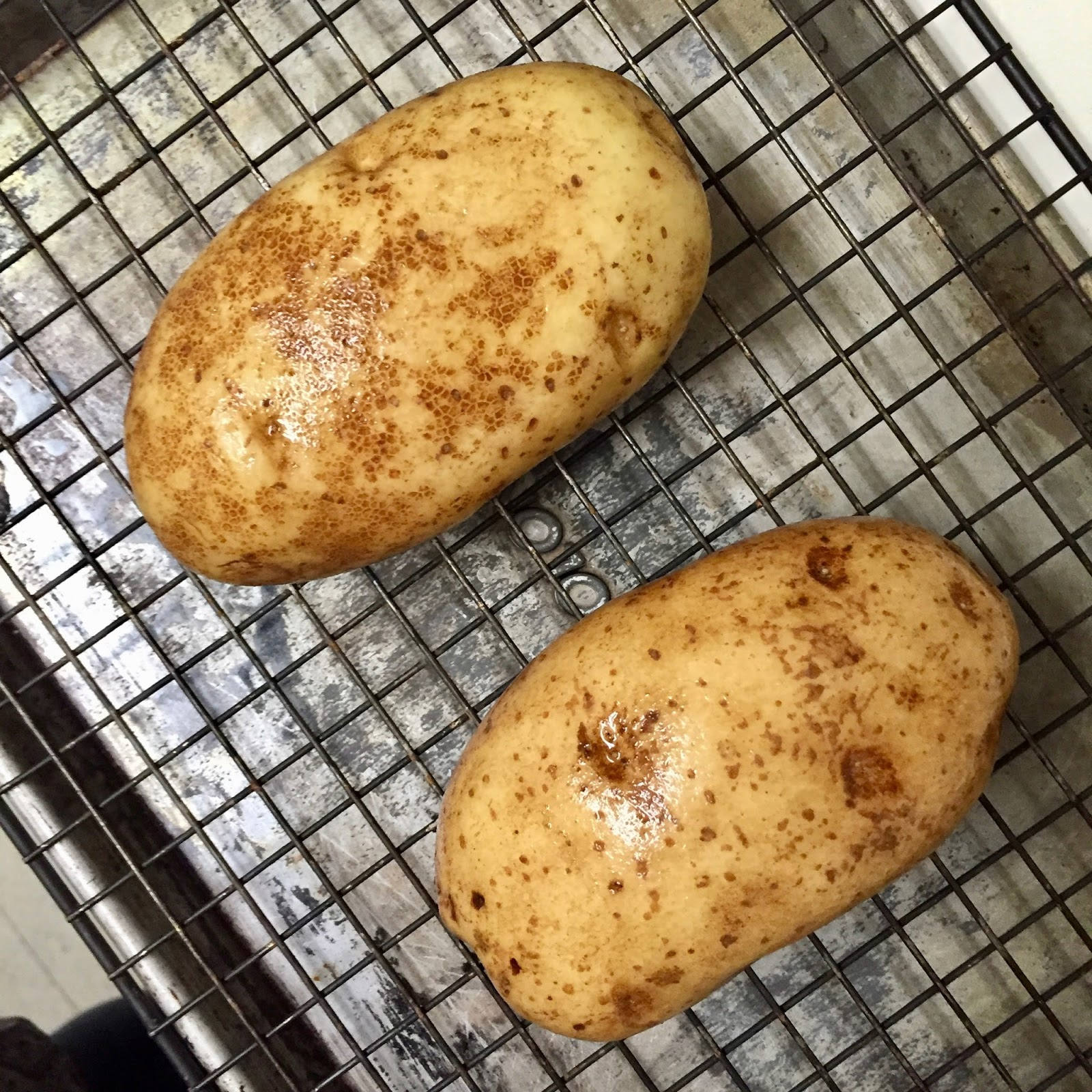 remove potatoes from oven and brush tops and sides with olive oil or bacon or duck fat return potatoes to oven and continue to bake for 10 minutes - Americas Test Kitchen Baked Potato