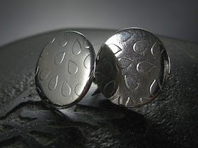 electro etched sterling silver using silver nitrate earrings.  Dew drop design cut in vinyl with Silhouette Cameo as a resist.  Tutorial by Nadine Muir for Silhouette UK