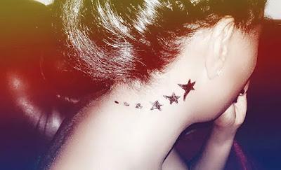 Shooting Star Tattoo behind ear