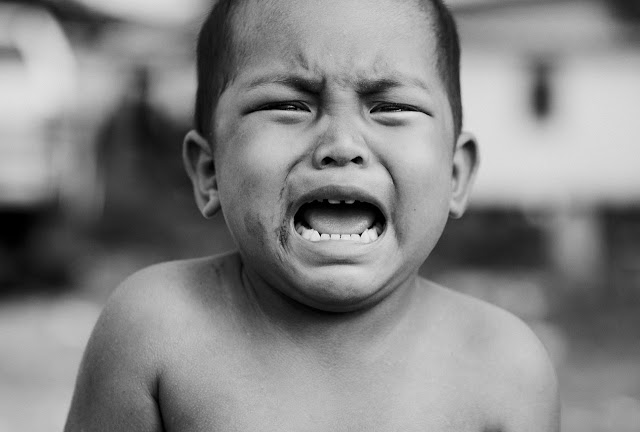 Young boy crying hard