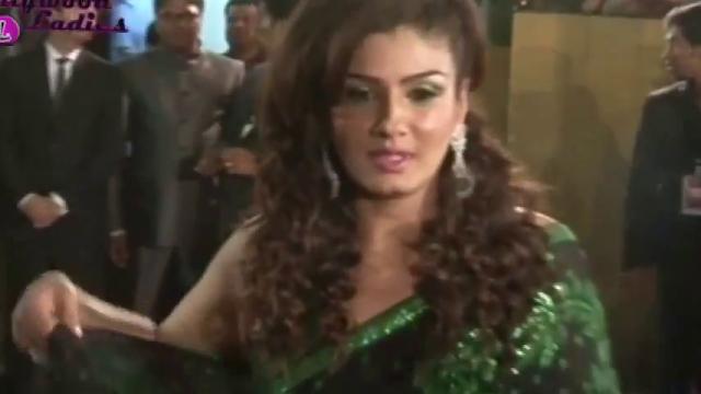 South Actress Hot Pics: Raveena Tandon Full Backless Green