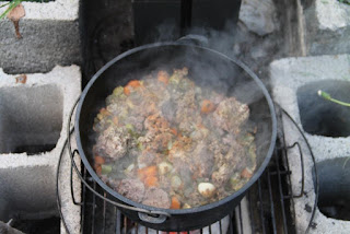 Hobo cooking in dutch oven