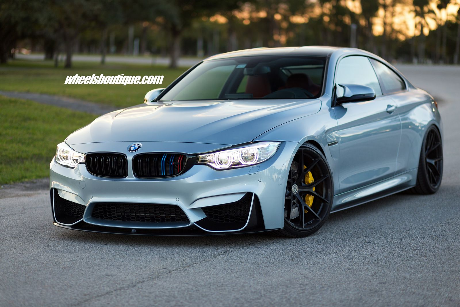 bmw m4 tries on matte black wheels on a lowered body