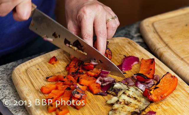 Giving the charred veggies a rough chop.