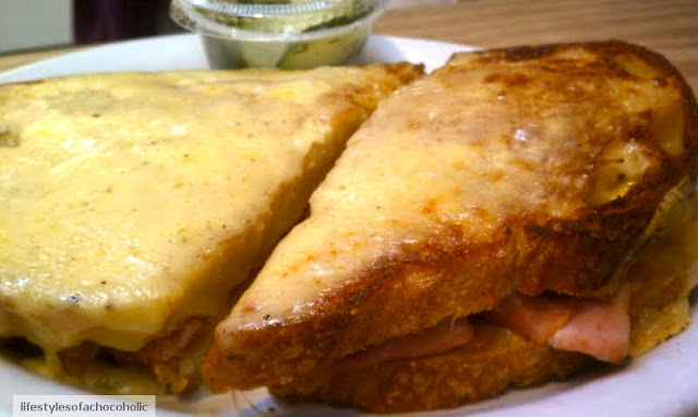 croque monsieur sandwich on a white plate