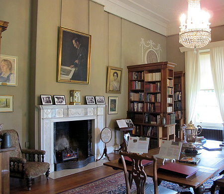 Books and family photographs at Killerton House