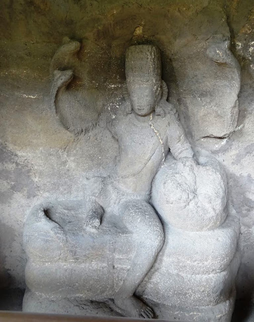 Nagaraja sculpture at the entrance of Ajanta cave 16