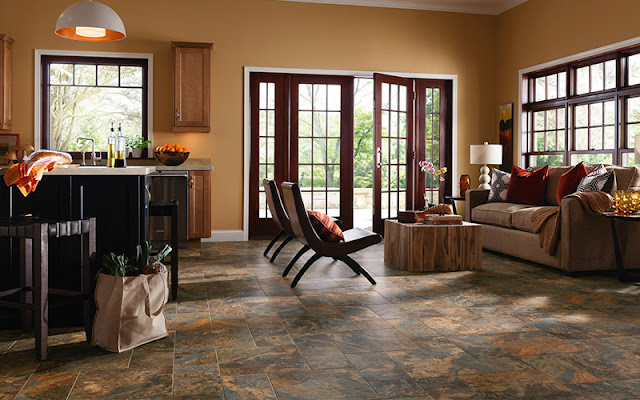 Beautiful tile flooring stands up to everything this kitchen/sitting area has to offer.