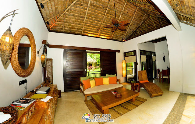 Living and Dining area of Water Villa @ The Banjaran. If you open the doors it reveals the view of villas on water