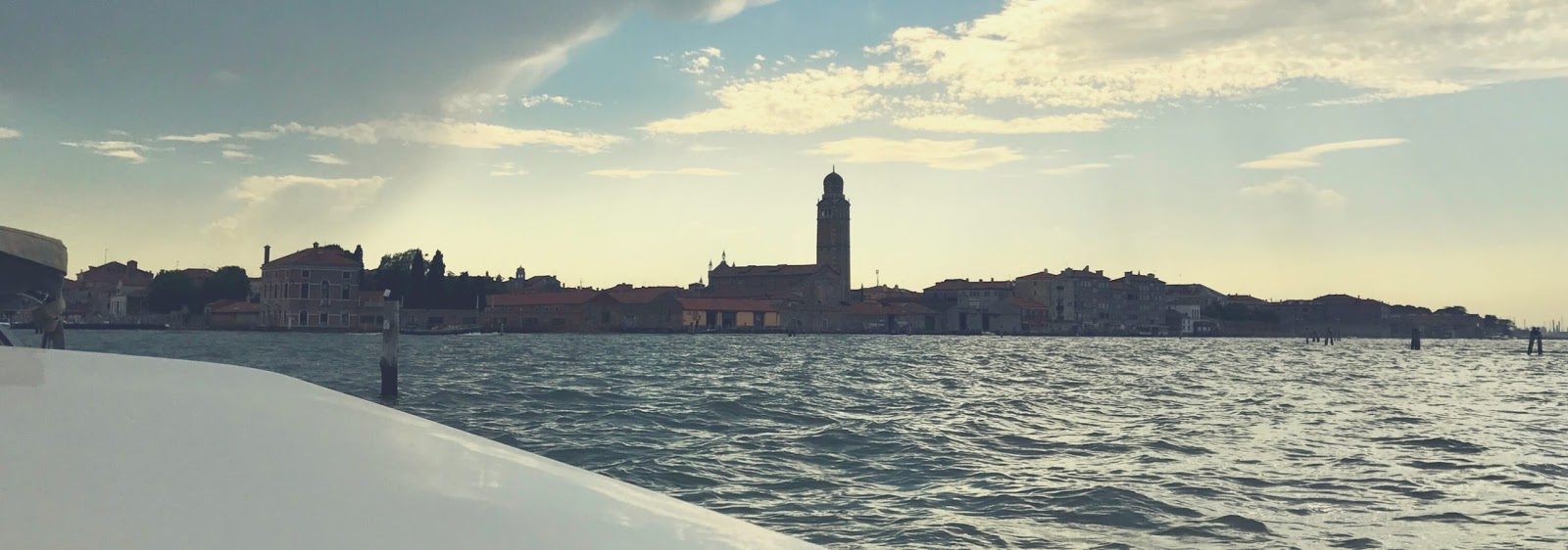 Taxi ride to Venice, venetian architecture against a cloudy sky