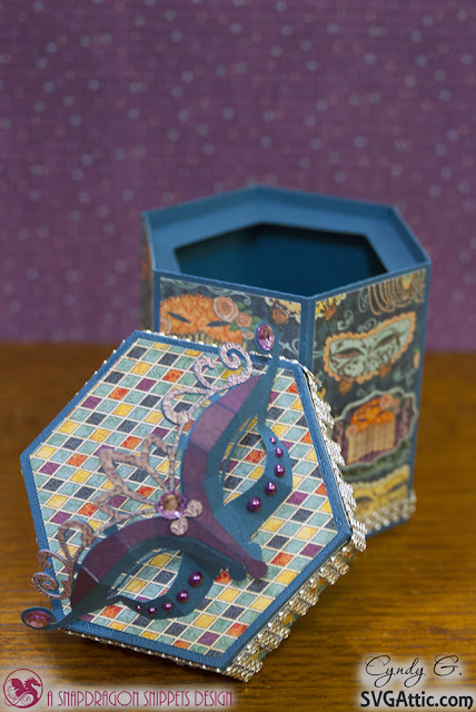 Hexagon box with 3d masquerade mask on top - open