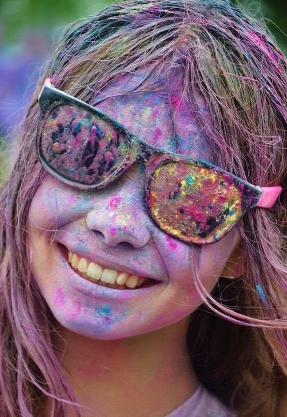 girl wearing glasses while playing holi