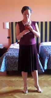 The author dressed for a milonga in a plum-coloured knee-length flared velvet skirt and plum-coloured chiffon top