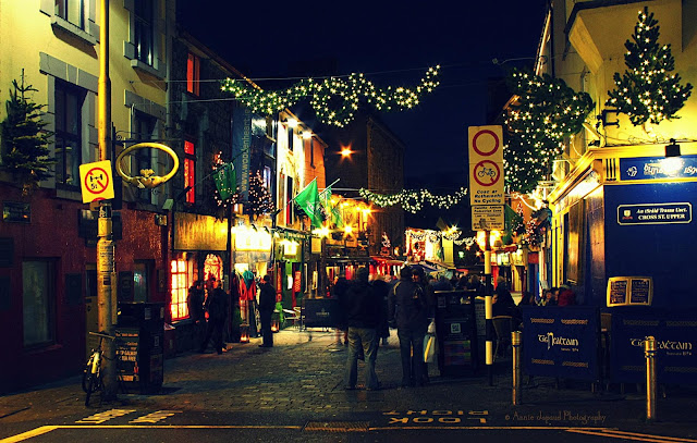 Shop street image in the dark at Christmas, Galway