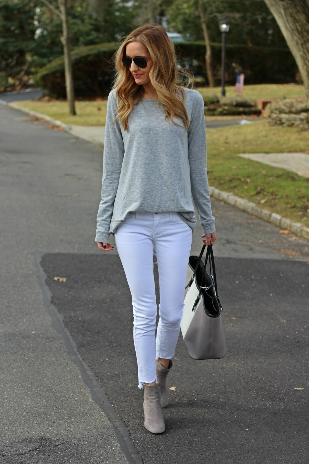 8f60fd4fb3e Summer Outfit Idea  White Jeans – chambray shirt tucked into belted low-rise  white jeans